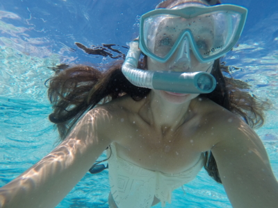 Snorkeling in The Cayman Islands | Caribbean vacation | THings to do in the CAymans | Mandy Carter travel writer | Florida travel blog | cayman vacation | Acupful.com family travel blogger | 7 mile beach snorkel | Red Sail Sports | Swim with Stingrays | Stingray City